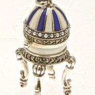 SILVER FABERGE EGG WITH SILVER STAND