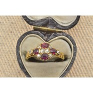 ANTIQUE RUBY AND DIAMOND OVAL CLUSTER RING