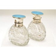 ANTIQUE SILVER AND ENAMELED PERFUME BOTTLES