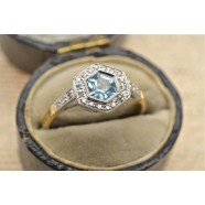 DIAMOND AND BLUE TOPAZ CLUSTER RING