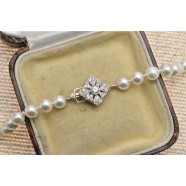 CULTURED PEARLS WITH WHITE GOLD DIAMOND SET CLASP