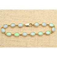 9CT GOLD OPAL RUB OVER  BRACELET