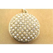 ANTIQUE DIAMOND AND SEED PEARL LOCKET